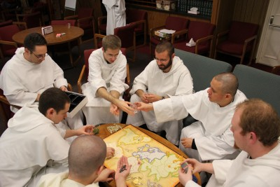 Dominicans Playing a Board Game