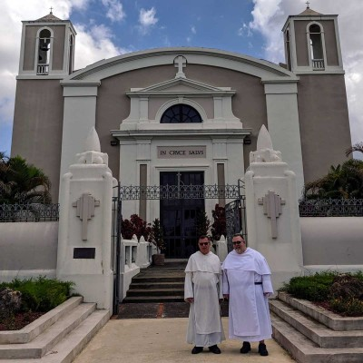 Two Dominicans in front of a church