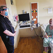 Fr. Pat Norris, OP, chaplain at SSM Health St. Mary's Hospital in Madison, visits with patient Tom Donahue of Madison. (Photo courtesy of SSM Health St. Mary's Hospital)